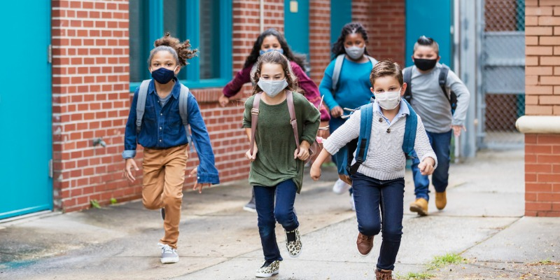 school kids running with face masks